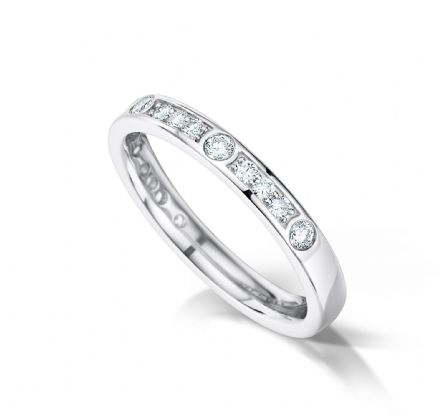Grain set court eternity/wedding ring, platinum. Alternate grain/rubover setting.